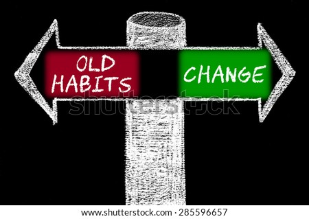 Opposite arrows with Old Habits versus Change.Hand drawing with chalk on blackboard. Choice conceptual image - stock photo