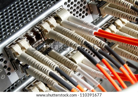 optic fiber cables connected to hub - stock photo