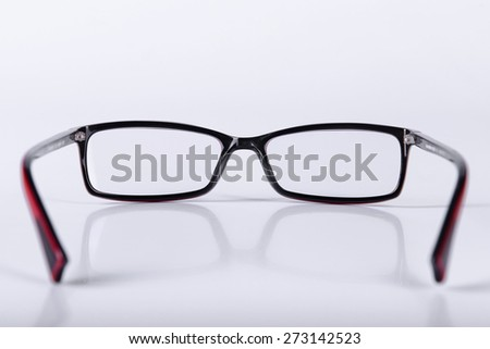 optical glasses on a light gray background closeup - stock photo