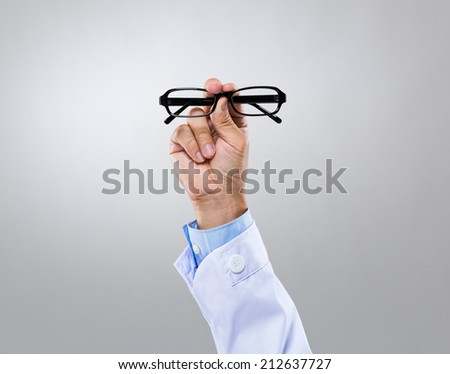 Optician doctor hold with eye glasses - stock photo