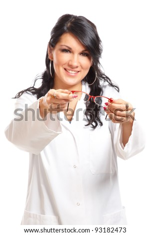 Optician or oculist woman giving a pair of glasses - stock photo