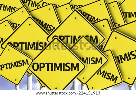 Optimism written on multiple road sign - stock photo