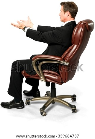 Optimistic Caucasian man with short black hair in business formal outfit pointing using palm - Isolated - stock photo