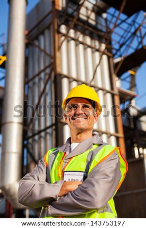 optimistic senior chemical industry worker in factory - stock photo