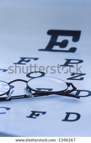 optometrist eye test chart blue - stock photo