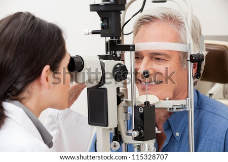 Optometrist performing visual field test - stock photo