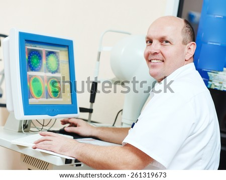 Optometry concept. Happy male optometrist optician doctor evaluate eyesight diagram in eye ophthalmological clinic  - stock photo