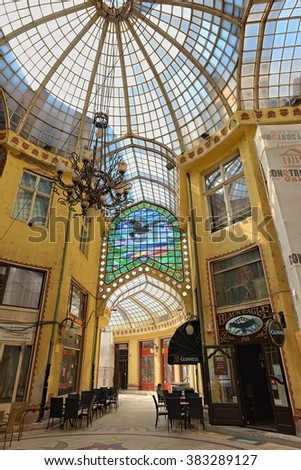 ORADEA, ROMANIA - AUGUST 01, 2015: The Black Eagle Palace equipped with a glass covered passageway is an architectural masterpiece.  - stock photo