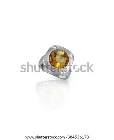 orange amber gemstone and diamond ring isolated on white - stock photo