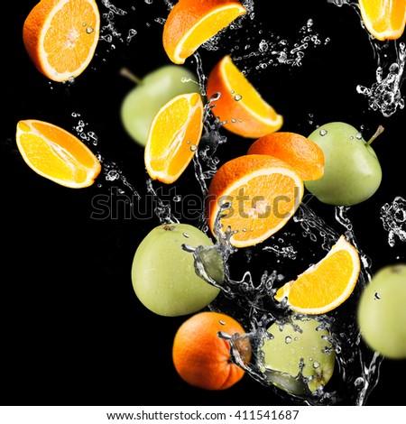 Orange and apples  fruits and Splashing water - stock photo