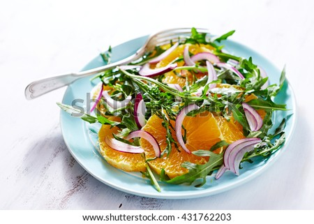 Orange and Arugula Salad - stock photo