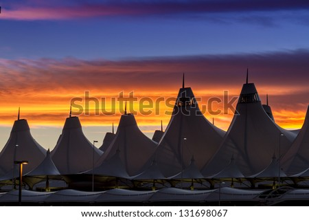 Orange and blue Bronco sunset over the tents of Denver International AIrport - stock photo