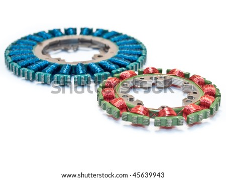 Orange and blue disc motors as used in video, tape, CD, and DVD players - stock photo
