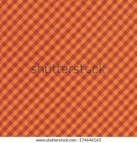 Orange and brown diagonal checkered tablecloth background. - stock photo