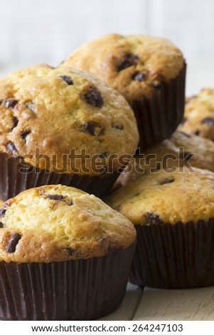 Orange and Chocolate Muffins Stacked up on a Table - stock photo