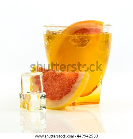 orange and grapefruit juice in glass ower white background - stock photo
