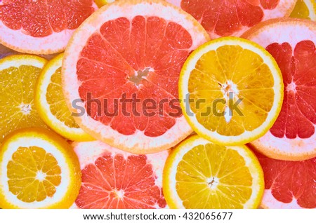 Orange and grapefruit rings background - stock photo
