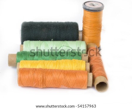 orange and green bobbins - stock photo