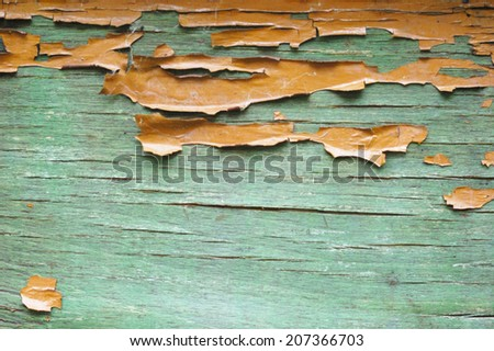 orange and green wooden background with peeling paint - stock photo