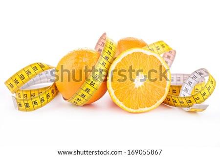 orange and measuring tape - stock photo