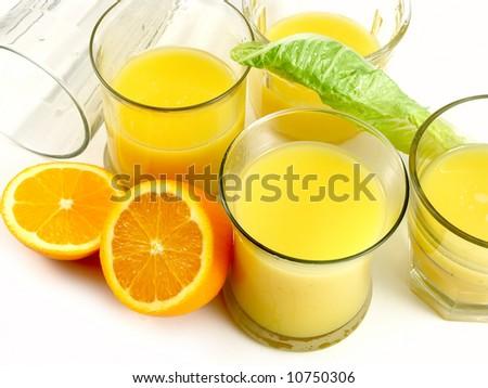 Orange and orange juice in a glass - stock photo