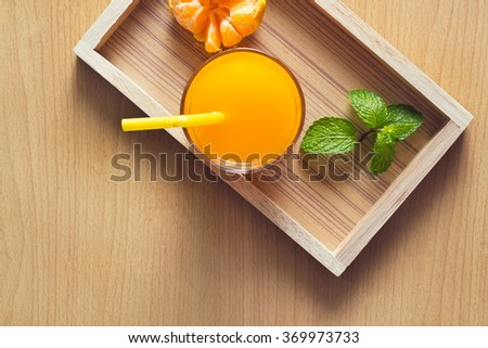 Orange and orange juice with mint in tray wood on wooden background, Top view - stock photo