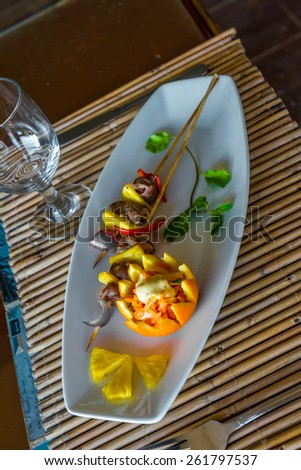 orange and pineapple appetizer served on plate in restaurant or cafe - stock photo