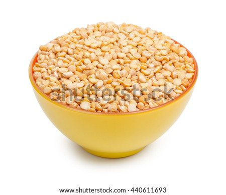 Orange and yellow colors ceramic bowl with dried peas isolated on white background - stock photo