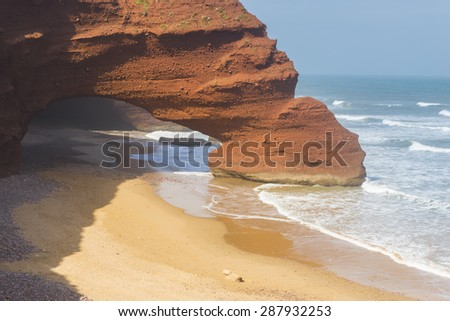 Orange arch on Legzira beach, Morocco - stock photo