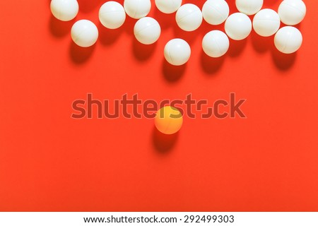 Orange ball and white balls, Think different concept or Leadership concept - stock photo