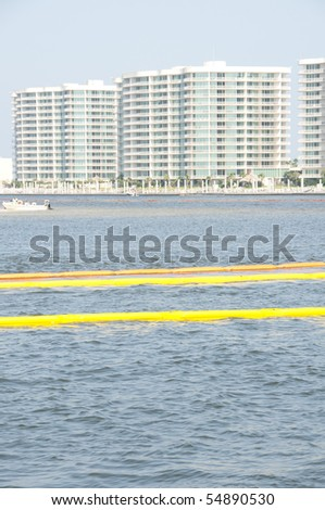 ORANGE BEACH, AL - JUNE 8: Protective oil boom is placed in front of resorts on June 8, 2010 in Perdido Pass in Orange Beach, AL as the BP oil slick threatens wildlife and tourism in the area . - stock photo