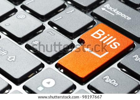 Orange bills button on the keyboard - stock photo