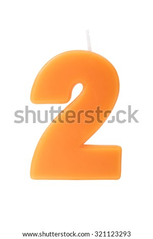 Orange birthday candle in the form of the number two on white background - stock photo