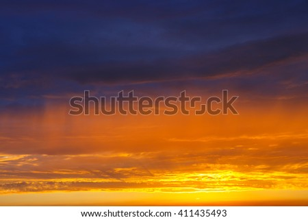 orange, blue and yellow colors, sunset sky  - stock photo