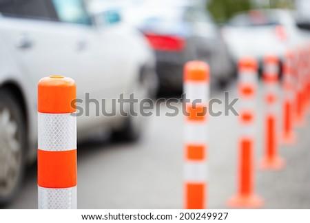 Orange bollard on the road. Traffic jam. - stock photo