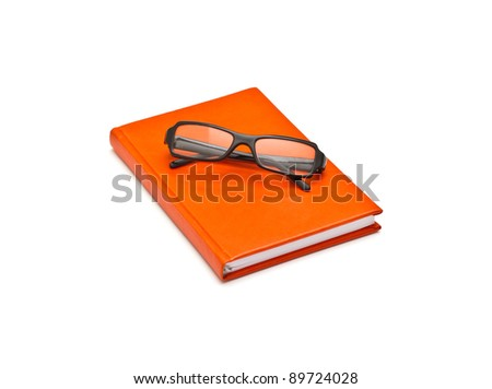 Orange book and glasses, isolated on white background - stock photo