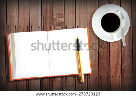 Orange book Wood Table with hot coffee - stock photo