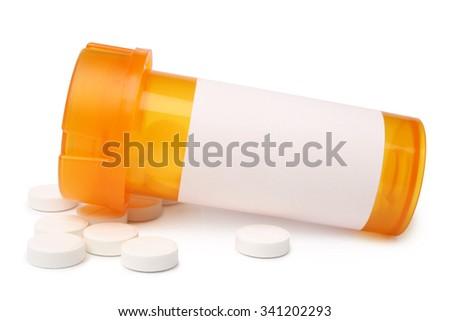 Orange bottle with tablets on white background - stock photo
