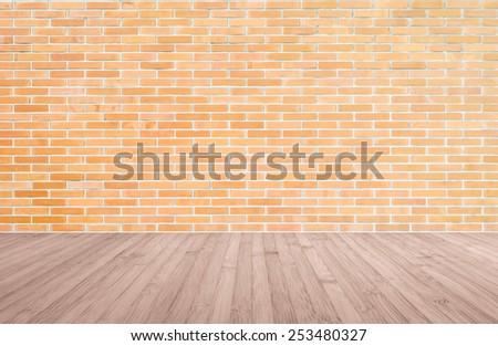Orange-brown brick wall with wood floor    - stock photo