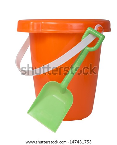 Orange bucket with white handle and green plastic shovel ready for summer fun isolated on white - stock photo