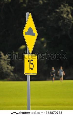 Orange Bump Street Sign 15km per Hour - stock photo