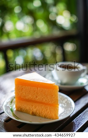 Orange Cake and Coffee background on wood table and bokeh background  - stock photo