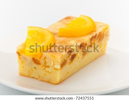 Orange cake melted with pieces of orange and topping on it for decorate - stock photo