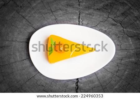 orange cake on wooden background - stock photo