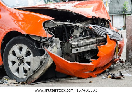 Orange car crash the wall. - stock photo