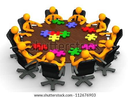 Orange cartoon characters with puzzles on table. - stock photo