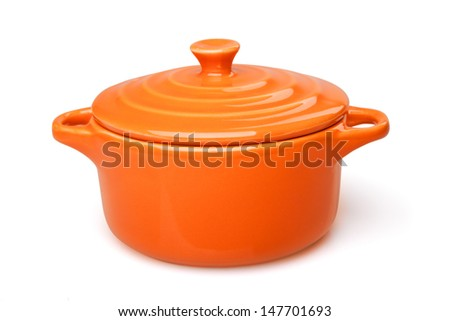 Orange casserole dish or crock pot, isolated on white. - stock photo