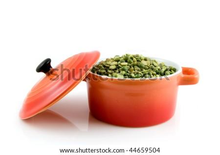 Orange casserole with green split peas isolated on white background - stock photo