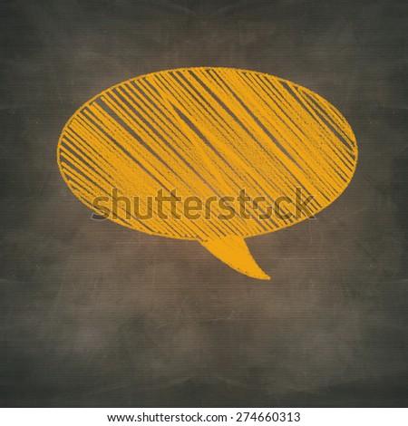 orange chalk speech bubble on grunge background - stock photo