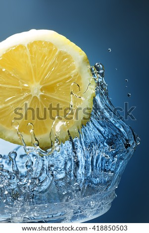 orange citrus in blue water - stock photo